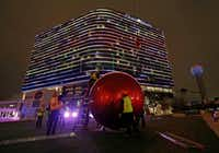 Workers install a giant red Christmas ornament outside the Omni Dallas Hotel in Dallas, Wednesday, Nov. 15, 2017. In 2019, a streetcar could come by, too.(Jae S. Lee/Staff Photographer)