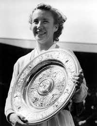 "In this July 5, 1952, file photo, Maureen ""Little Mo"" Connolly, of San Diego, Ca., smiles as she holds her trophy after winning the final in the women's singles at the All England Lawn Tennis Championships in Wimbledon, London. (File Photo/The Associated Press)"