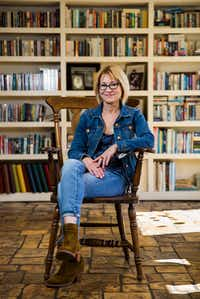 Author Elizabeth Crook poses for a portrait in her living room in Austin.(Ashley Landis/Staff Photographer)
