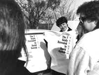 March 12, 1993: Rosaline Eastepp, of Garland, attempted to sell T-shirts to two women in Waco to observe the stand off.(Irwin Thompson/Staff Photographer)