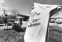 "March 23, 1993: Linda Cox sold T-shirts near the compound, including this shirt reading, ""My parents went to Mt. Carmel and all I got was this lousy AK-47!""(Beatriz Terrazas/The Dallas Morning News)"