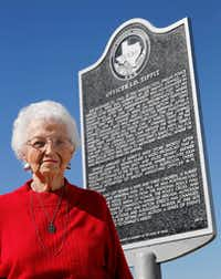 Marie Tippit poses for a photo next to a plaque dedicated to her husband near the intersection of 10th Street and Patton Avenue in Dallas on Jan. 24, 2018. Tippit is the 89-year-old widow of Officer J.D. Tippit, killed by Lee Harvey Oswald before his arrest. Mrs. Tippit wanted to be buried beside her husband, but Laurel Land cemetery, where he was buried in 1963, would not help her. The Watchdog intervened, and she got her wish. (Vernon Bryant/Staff Photographer)
