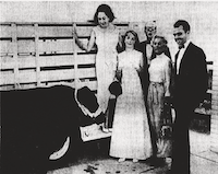 From June 7, 1966: The once-over, Black Angus and bidders. From left, Mrs. Jake Hamon, Miss Laura Fisher, Hamons' granddaughter; Peter Matisse, Mrs. Estill Heyser Jr. and Gilbert Lloyd from London. Mr. Matisse much preferred ponies to the black bull and took them on high bid during a brisk TACA auction.(Fred Coston/DMN Staff)