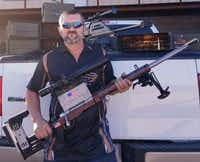 Bill Poor and his .408-caliber rifle.(Bill Poor)