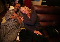 Johnnie Lindsey, a Texas exoneree who spent 26 years in prison for a crime he didn't commit, laughs with Dorothy Budd, author of <i>Tested: How Twelve Wrongly Imprisoned Men Held Onto Hope</i>, at his home in Dallas on Jan. 24, 2018. Lindsey is in hospice at his home for liver cancer and is one of the men featured in the book.(Rose Baca/Staff Photographer)