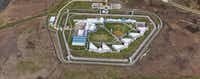 Authorities say prisoners have repeatedly left the facility to pick up contraband from neighboring property.(Google Maps)
