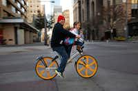 David Ramirez and his niece Giana Correa of Dallas rode a VBikes rental bicycle along the North Texas March for Life route in downtown Dallas on Jan. 20.(Tom Fox/Staff Photographer)