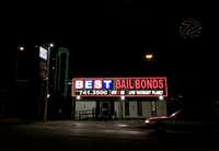 Lights from a bail bond business glow along Riverfront Boulevard in Dallas. Four nonprofits filed a federal civil rights lawsuit alleging the Dallas County jail's cash bail system unfairly harms poor people and violates the Texas and U.S. constitutions(Michael Hamtil/Staff photographer)