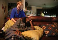 Michelle Moore, the attorney who helped exonerate Johnnie Lindsey gave him a back rub at his home in Dallas on Saturday.(Rose Baca/Staff Photographer)