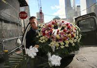 Firefighter John Manning delivered a wreath Monday to Engine Company 10 across from Ground Zero. Engine Company 10 lost six members on 9/11.