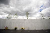 Mourners left flowers Monday at the memorial wall, which bears the names of 40 victims, at the Flight 93 National Memorial before ceremonies commemorating the 11th anniversary of the 9/11 attacks.