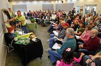 The class looks on as garden adviser Brieux Turner gives instructions during a Growing Vegetables by Seed class at North Haven Gardens in Dallas on Jan. 27. (Stewart F. House/Special Contributor)