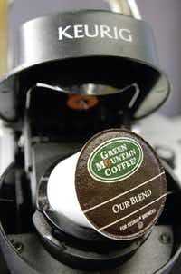 A Green Mountain Coffee single-serving brewing cup is seen in a Keurig machine.(Toby Talbot/The Associated Press)