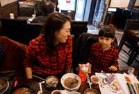 Elise Hu, NPR reporter, eats dinner with her daughter, Eva, 5.(Byron Harris/Special contributor)