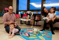 Elise Hu, NPR reporter, spends time with her husband, Matt Stiles, and daughters Isa, 2, and Luna, who is 9 months old, at their apartment in Seoul, South Korea.(Byron Harris/Special contributor)