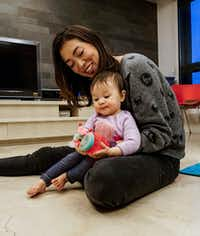 NPR reporter Elise Hu plays with her 9-month-old daughter Luna in their apartment in Seoul, South Korea.(Byron Harris/Special contributor)