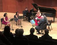 Pianist Jon Nakamatsu and the Imani Winds--L to R, Julietta Curenton (flute), Toyin-Spellman-Diaz (oboe), Monica Ellis (bassoon), Mark Dover (clarinet) and Jeff Scott (horn)--prepare to play the Poulenc Sextet for piano winds on Jan. 29, 2018 at Caruth Auditorium, Southern Methodist University (Scott Cantrell/Special Contributor )