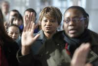 Ngozi Ikeogu of Nigeria, center, was one of 100 applicants from 34 countries sworn in as newly naturalized citizens in a Citizenship Swearing In Ceremony at the U.S. Citizenship and Immigration Services Field Office on Jan 14, 2013.  (Michael Ainsworth/The Dallas Morning News)(Staff/2013 File Photo)