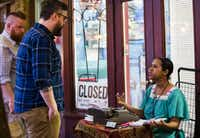 Street poet Fatima Hirsi talks to customer Chris Hart, second from left, on Friday, March 4, 2016 outside El Jordan Cafe on Bishop Ave in Dallas. At left is Patrick McCray. (Ashley Landis/Staff Photographer)