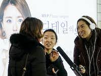 NPR reporter Elise Hu and producer Se Eun Gong conduct interviews for a story on cosmetic surgery in South Korea.(Byron Harris/Special contributor)