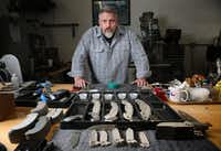 Todd Begg poses for a photograph at his shop where he crafts knives in Dallas.(Rose Baca/Staff Photographer)
