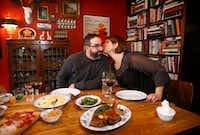 David and Jennifer Uygur prepare a Valentine's dinner at their North Oak Cliff home in Dallas.(Tom Fox/Staff Photographer)