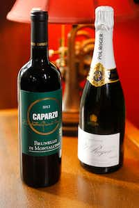 Lucia restaurant owners David and Jennifer Uygur prefer Caparzo Brunello di Montalcino red wine (left) and Pol Roger Brut Reserve for Valentine's dinner.(Tom Fox/Staff Photographer)