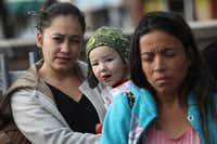 """Immigrant families wait at a Catholic Charities sponsored """"immigrant respite center"""" before taking a bus from the border into the interior of the United States on Jan. 4, 2017 in McAllen, Texas. They had been detained, processed and released by the U.S. Border Patrol pending a judicial hearing of their asylum petition. Thousands of families and unaccompanied children, most from Central America, are crossing the border illegally to request asylum from violence in their home countries.(John Moore/2017 File Photo/Getty Images)"""