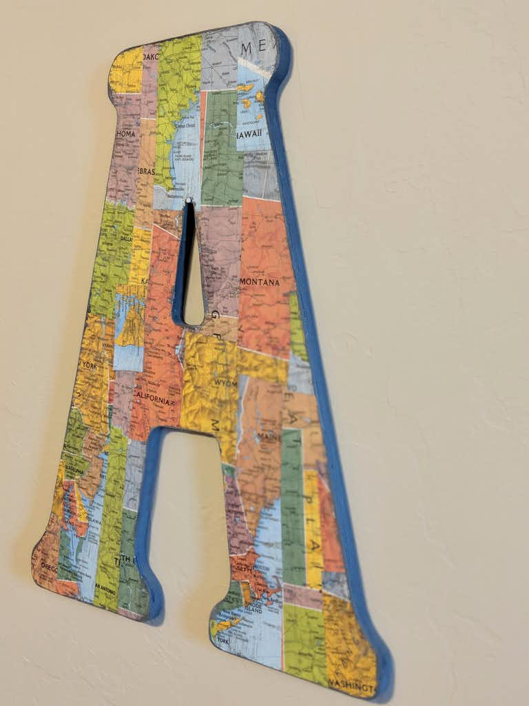 This undated photo provided by Melissa Smuzynski shows a capital A decoupaged in a US map on the wall in a travel-themed nursery.(AP)