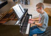 Twenty-one-year-old Ryan Bartek enjoys playing the piano and is in the Frisco youth orchestra. His parents, Doug and Jodi, support 29 Acres for people like Ryan who are on the autism spectrum.(Robert W. Hart/Special Contributor)