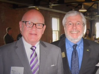 Robert Leonard (left), CEO of Force Multiplier, and Larry Duncan, former president of the board of trustees for the Dallas County Schools bus agency, at a social gathering.