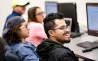 Student Robert Gallegos reacts to Super Bowl ad Thursday in the Integrated Marketing Communications and Advertising class at the University of Texas at Arlington. (Tom Fox/Staff Photographer)