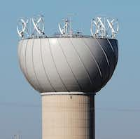 Wind turbines on top of a water tower in Addison were supposed to be a merger of art and technology. Instead, it turned into a $1 million flop and a lawsuit. Why? Blades kept falling off.(Vernon Bryant/Staff Photographer)