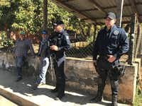 Police Chief Jose Hugo Sanchez Mendoza (center) and his top assistant, Jose Antonio Flores Quezada (right) meet with community residents for updates on security. The police force is funded by the city of Tancitaro and powerful avocado farmers, who remain fearful of criminal organizations.(Alfredo Corchado)
