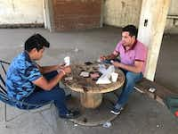Gustavo Cortez plays cards with his cousin Cesar Cortez as they began their shift to help protect their community of Aguacate Sur from criminal groups who once terrorized residents with extortions, kidnappings and killings.(Alfredo Corchado/The Dallas Morning News)