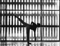 A dancer with the Dallas Black Dance Theatre stretching out before a rehearsal session in their Bishop College studio in 1988. (Paul Brown /The Dallas Morning News)