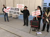 Charles Park and Sinmin Pak, center, speak out against China holding North Korean refugees at a small protest Jan. 30 at JFK Memorial Plaza in Dallas.(Staff/Deborah Fleck)