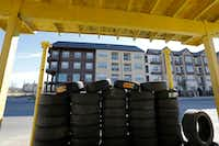 Hernandez New and Used Tires sits across the street from Austin at Trinity Green. Some feel that new housing developments in West Dallas may be too expensive since the median household income in some of the area's census tracks is only $40,000 a year.(David Woo/Staff Photographer)