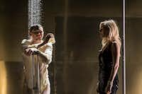 Jack O'Connell (Brick), left, and Sienna Miller (Maggie) act out a scene from <i>Cat on a Hot Tin Roof</i>. The National Theatre production in London will be shown live via NT Live at the Angelika movie theater in Dallas. (Johan Persson/National Theatre Live)