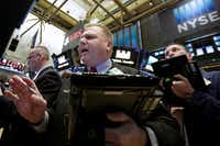 Trader George Ettinger, center, works on the floor of the New York Stock Exchange on Tuesday, Feb. 6, 2018.(Richard Drew/AP)