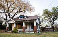 This 125-year-old house at 1107 E 11th St., built in the late 1800s, is on the city's to-tear-down list.(Ashley Landis/Staff Photographer)
