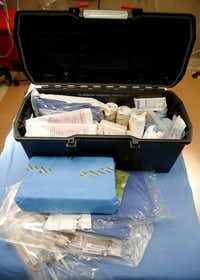 The kit that Dr. Al West of Medical City Plano took with him to amputate the right leg of Francisco Palma after a construction accident.(Vernon Bryant/Staff Photographer)
