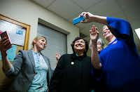 Gubernatorial candidate and former Dallas Sheriff Lupe Valdez takes selfies with supporters at The Mid-Cities Democrats Gubernatorial Forum and Chili Dinner on Tuesday, February 6, 2018 at the UAW 218 Union Hall in Hurst, Texas. (Ashley Landis/Staff Photographer)