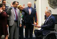 <p>Gov.&nbsp;Greg Abbott swears in new Dallas Police Association board members before&nbsp;announcing grant funding for rifle-proof vests for Texas police officers.&nbsp;(Rose Baca/The Dallas Morning News)</p>
