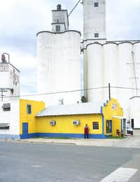 <i>Grain elevators, Pastor Lopez, Michoacana Restaurant, Perryton</i>, 2010(Peter Brown/PDNB Gallery)