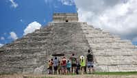 Tourists are dwarfed by El Castillo at the Chichen-Itza ruins in Yucatan, Mexico. While beach destinations remain popular for spring break, travel agents say customers are also demanding unique cultural experiences and active outdoorsy adventures.(Ross D. Franklin/AP)