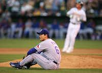 Chan Ho Park #61 of the Texas Rangers looks to second base after a throwing error that scored a run on a ball hit by Mark Kotsay #21 of the Oakland Athletic during an MLB game at McAfee Coliseum on July 14, 2005 in Oakland, California. (Jed Jacobsohn/Getty Images)