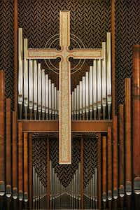 The organ and a mosaic cross inside the sanctuary.(Andy Jacobsohn/Staff Photographer)