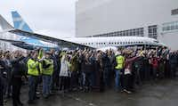 Employees gathered for a photo after the first Boeing 737 MAX 7 aircraft was unveiled on the tarmac outside of the Boeing factory on Feb. 5, 2018, in Renton, Wash. The 737 MAX 7 will have the longest range of the MAX airplane line with a maximum range of 3,850 nautical miles. (Stephen Brashear/Getty Images)