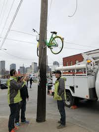 "Someone sawed a LimeBike in half and bolted it to a Deep Ellum phone pole last month. LimeBike tweeted this photo and said it was ""proud to serve"" Dallas.(LimeBike)"